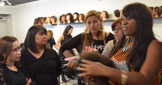 Women in salon learning how to style hair