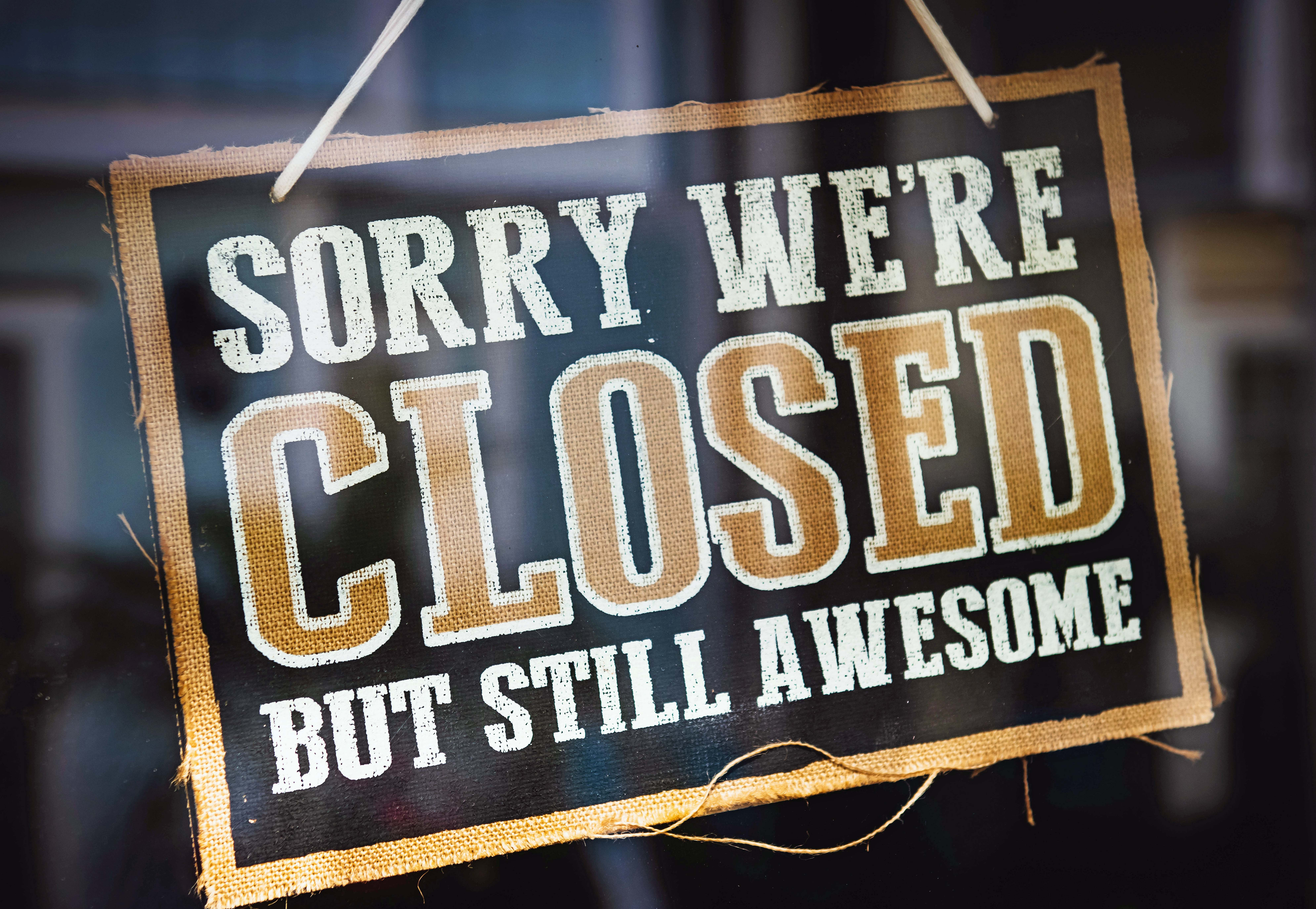 "Sign says ""Sorry We're Closed But Still Awesome"""
