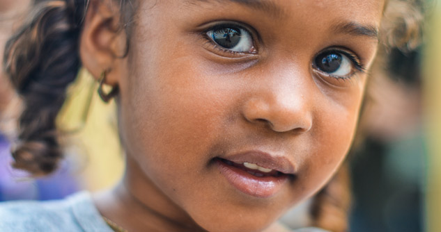 Close up of young black girl, slight smile