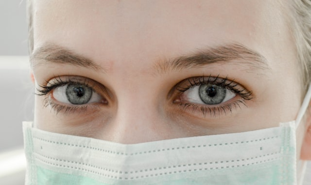 Close up of nurse, kind eyes, wearing mask
